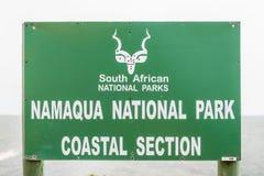 Znak przy Namaqua parka narodowego nabrzeżną sekcją Zdjęcia Royalty Free