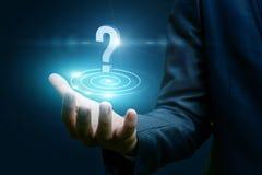 Znak zapytania w biznesmena ` s ręce Fotografia Stock
