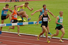 Znamensky Memorial 2014. Zhukovsky, Moscow region, Russia - June 27, 2014: Athletes in men 3000 meters steeplechase during Znamensky Memorial. The competitions royalty free stock images