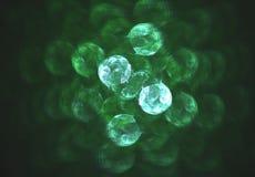 Zniekształcający szklany bokeh zieleni abstrakta tło Obrazy Stock