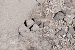 Zniszczony asfaltowy bruk fotografia royalty free