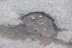 Zniszczony asfaltowy bruk fotografia stock