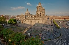The zocalo in mexico city with the cathedral and giant flag in the centre. Modern architecture, street, parks and building in the centre of Mexico city Stock Photography
