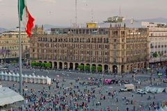 The zocalo in mexico city with the cathedral and giant flag in the centre. Modern architecture, street, parks and building in the centre of Mexico city Stock Photo