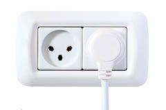 Zoccoli elettrici con la spina isolata su bianco Fotografia Stock