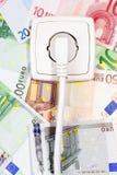 Zoccolo di potenza e delle banconote Fotografia Stock