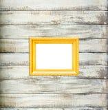 Złocista Rocznika obrazka rama na starym drewnianym tle Zdjęcia Royalty Free