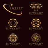 Złocistej biżuterii loga i kwiatu loga wektoru Diamentowy ustalony projekt Obraz Stock