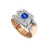 Złocisty pierścionek z diamentami i szafirem Fotografia Stock