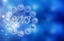 Zodiac and 2013. Zodiac signs and year of 2013 over starry blue background with copy space royalty free illustration