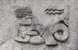 Zodiac - Aquarius or Water-bearer. A stone relief Royalty Free Stock Photo