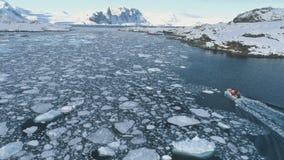 Zodiac boat in Antarctica ocean aerial shot