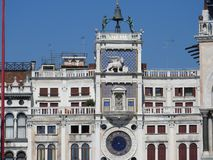 Zodiac clock. Clock Tower with winged lion and two moors striking the bell - early Renaissance 1497 building in Venice, located. The north side of Piazza San stock photography