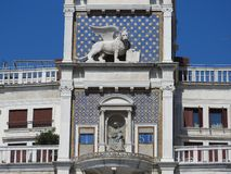 Zodiac clock. Clock Tower with winged lion and two moors striking the bell - early Renaissance 1497 building in Venice, located. The north side of Piazza San royalty free stock photo