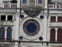 Zodiac clock. Clock Tower with winged lion and two moors striking the bell - early Renaissance 1497 building in Venice, located royalty free stock photography
