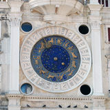 Zodiac Clock in Venice. Old zodiac clock with blue and gold details royalty free stock photography