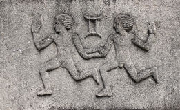 Zodiac - Gemini or Twins. A stone relief Stock Image