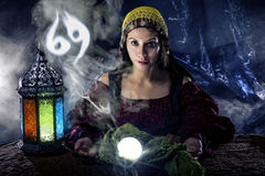 Zodiac Horoscope Symbol with Fortune Teller. Psychic or fortune teller with crystal ball and horoscope zodiac sign of cancer stock photography