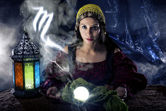 Zodiac Horoscope Symbol with Fortune Teller. Psychic or fortune teller with crystal ball and horoscope zodiac sign of Scorpio stock photography