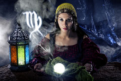 Zodiac Horoscope Symbol with Fortune Teller. Psychic or fortune teller with crystal ball and horoscope zodiac sign of Virgo stock image