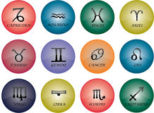 Zodiac multi. Vector graphic of buttons - zodiac signs with multicoloured glaze Stock Image