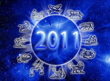 Zodiac and new year of 2011. Astrology concept with Universe, zodiac symbols and the new year of 2011 year vector illustration