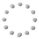 Zodiac pebbles. Set of 12 icons representing the zodiac symbols carved in stone on pebbles. Isolated on white background Stock Photos