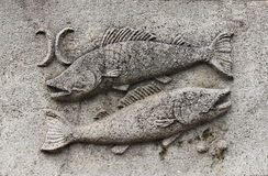 Zodiac - Pisces or fish. A stone relief royalty free stock photography