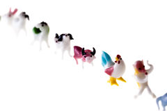 Zodiac row. Small glass sculptures representing the chinese zodiac signs isolated over a pure white background royalty free stock photography