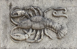 Zodiac - Cancer or Crab, a stone relief. Zodiac - Cancer or Crab, a relief on sand stone stock image