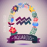 Zodiac sign AQUARIUS, in a sweet floral wreath. Horoscope sign, flowers, leaves and ribbon Royalty Free Stock Photo