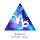 Zodiac sign Capricorn over hipster triangle with space galactic. Starry texture inside. Night sky full of stars. Vector galaxy design for horoscope predictions Stock Photography