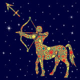 Zodiac sign Sagittarius with variegated flowers fill over starry Royalty Free Stock Photo