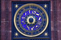 Zodiac signs on clock Stock Image