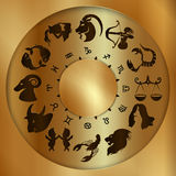 Zodiac signs on a gold disk Stock Image