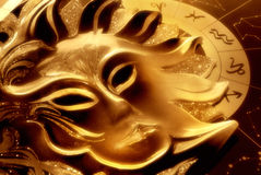 Zodiac with sun. Old mask of mysterious sun over astrological background in warm orange tonality royalty free stock photography