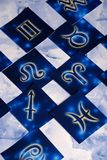 Zodiac symbols. Cards with astrological signs over blue marble background stock photo