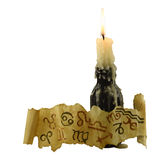 Zodiac symbols with candle in bottle. Zodiac symbols on paper with burning candle in black bottle isolated Royalty Free Stock Image