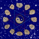 Zodiac symbols. Stones with signs of the zodiac on the background of the starry sky stock images