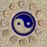 Zodiac symbols. Twelve stones with signs of the zodiac on a fine mineral crumb royalty free stock images