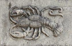 Zodiak - skorpion, kamienna ulga obraz stock