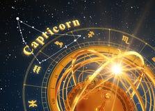 ZodiakteckenStenbocken och Armillary sfär på blå bakgrund Arkivfoto