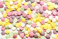 Zoet kleurrijk kleurensuikergoed - bestrooit suikergoedachtergrond royalty-vrije stock afbeeldingen