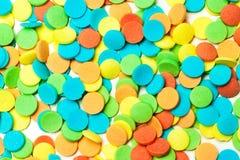 Zoet kleurrijk kleurensuikergoed - bestrooit suikergoedachtergrond stock afbeelding