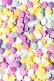 Zoet kleurrijk kleurensuikergoed - bestrooit suikergoedachtergrond stock fotografie