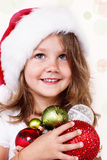 Zoet meisje in de hoed van de Kerstman royalty-vrije stock fotografie