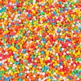 Zoet suikergoed die gebakjedecoratie uitspreiden stock foto's