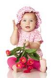 Zoete baby met bloemen stock afbeelding