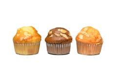 Zoete die muffins op wit worden geïsoleerd Stock Foto's