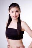 Zoete glimlach Aziatische vrouw stock foto's